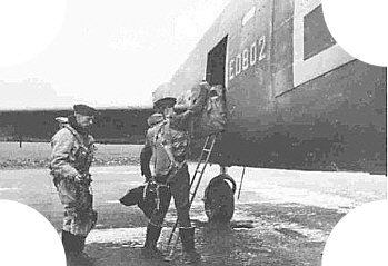 Iain Nicolson, DFC,DFM. loading his gear aboard before the Peenemunde Raid
